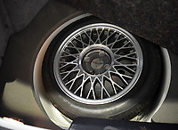 BNPS.co.uk (01202 558833)<br /> Pic: PPMMiltonKeynes/BNPS<br /> <br /> Spare wheel in a car that will set you back a lot of spare change. <br /> <br /> A pre-production prototype of the legendary Ford Sierra Cosworth RS500 has emerged for sale for a whopping £120,000.<br /> <br /> The RS500 was the road going version of Ford's iconic rally car with only 500 built in order to meet racing regulations.<br /> <br /> This one was the very first to be built in 1987 and in more recent times was road tested by Richard Hammond on the Grand Tour.