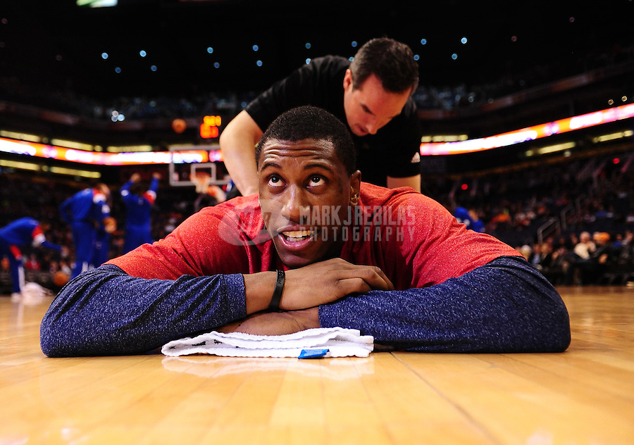 Dec. 28, 2011; Phoenix, AZ, USA; Philadelphia 76ers forward Thaddeus Young with trainer before game against the Phoenix Suns at the US Airways Center. The 76ers defeated the Suns 103-83. Mandatory Credit: Mark J. Rebilas-USA TODAY Sports