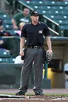 Home plate umpire Marcus Pattillo during a game between the Louisville Bats and Rochester Red Wings at Frontier Field on May 15, 2012 in Rochester, New York.  Rochester defeated Louisville 5-4.  (Mike Janes/Four Seam Images)