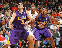 Jan. 2, 2011; Charlottesville, VA, USA; LSU Tigers forward Garrett Green (3), Virginia Cavaliers forward Akil Mitchell (25) and LSU Tigers guard Aaron Dotson (45) looks for the rebound during the game at the John Paul Jones Arena. Virginia won 64-50. Mandatory Credit: Andrew Shurtleff