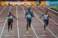 Usain BOLT (Centre) of Jamaica (Men's 100m) crosses the line to win his heat in 9.87 during the Sainsburys Anniversary Games Athletics Event at the Olympic Park, London, England on 24 July 2015. Photo by Andy Rowland.