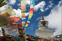 Colorful tibetan prayer flags in strong wind.