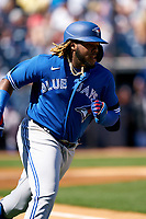 Toronto Blue Jays Vladimir Guerrero Jr. (27) runs to first base during a Spring Training game against the New York Yankees on February 22, 2020 at the George M. Steinbrenner Field in Tampa, Florida.  (Mike Janes/Four Seam Images)