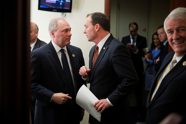 UNITED STATES - FEBRUARY 12: House Majority Whip Steve Scalise, R-La., and Sen. Mike Lee, R-Utah, gather for a bicameral news conference in the Capitol Visitor Center to urge passage of the Homeland Security Department funding bill, February 12, 2015. Rep. John Carter, R-Texas, appears at right. (Photo By Tom Williams/CQ Roll Call)