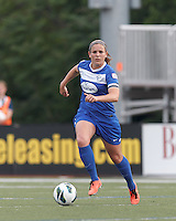 Boston Breakers defender Cat Whitehill (4) brings the ball forward.  In a National Women's Soccer League Elite (NWSL) match, Sky Blue FC (white) defeated the Boston Breakers (blue), 3-2, at Dilboy Stadium on June 16, 2013.