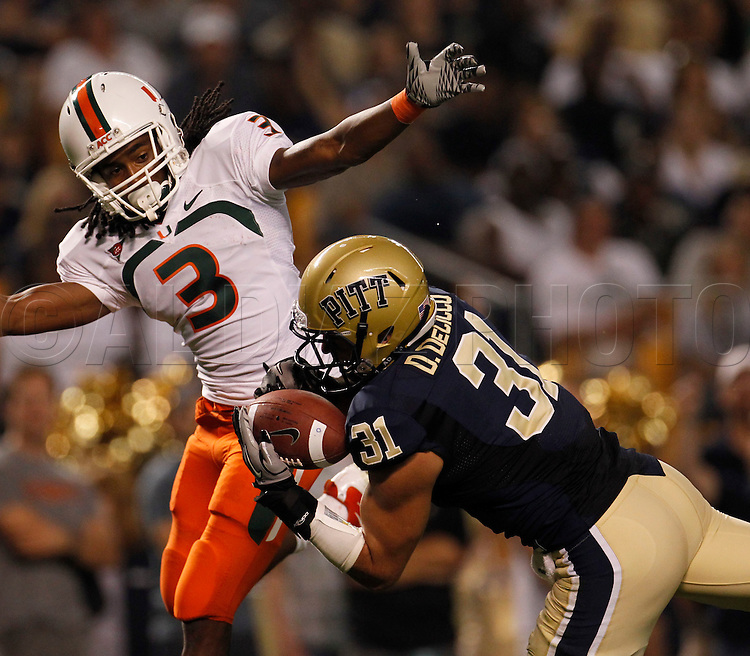 Pittsburgh Panthers cornerback Dom DeCicco (31) pulls in the first of two Miami quarterback Jacory Harris (12) passes in the first quarter. The pass was intended for Miami Hurricanes wide receiver Travis Benjamin (3) during The University of Miami  vs The University of Pittsburgh Panthers at Heinz Field in Pittsburgh, PA, on Thursday, September 23, 2010.