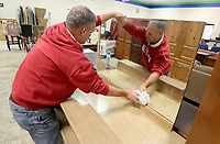 NWA Democrat-Gazette/DAVID GOTTSCHALK Mike Sevak, manager at the Benton County Habitat for Humanity ReStore, cleans a mirror Wednesday, November 6, 2019, in the showroom area of the  store in Bentonville. The ReStore is open Monday through Saturday and will pick up scheduled items and receive donations at the store from 9:00 a.m. to 4:30 p.m..