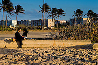 "Cuban lovers, embracing each other, sit on the ruins of a devastated sea promenade in Alamar, a huge public housing complex in the Eastern Havana, Cuba, 9 February 2009. The Cuban economic transformation (after the revolution in 1959) has changed the housing status in Cuba from a consumer commodity into a social right. In 1970s, to overcome the serious housing shortage, the Cuban state took over the Soviet Union concept of social housing. Using prefabricated panel factories, donated to Cuba by Soviets, huge public housing complexes have risen in the outskirts of Cuban towns. Although these mass housing settlements provided habitation to many families, they often lack infrastructure, culture, shops, services and well-maintained public spaces. Many local residents have no feeling of belonging and inspite of living on a tropical island, they claim to be ""living in Siberia""."