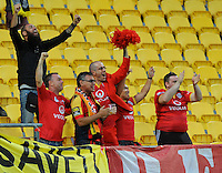 Adelaide United fans celebrate during the A-League football match between Wellington Phoenix and Adelaide United at Westpac Stadium, Wellington, New Zealand on Saturday, 6th March 2016. Photo: Nizaam Jones / lintottphoto.co.nz