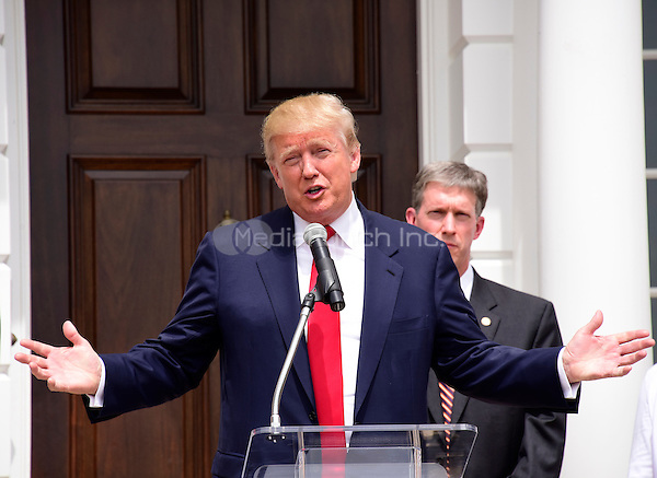 Donald Trump, a candidate for the 2016 Republican nomination for President of the United States, makes remarks during an appearance at the ribbon cutting for the Albemarle Estate at the Trump Winery in Charlottesville, Virginia on Tuesday, July 14, 2015. <br /> Credit: Ron Sachs / CNP/MediaPunch<br /> <br /> (RESTRICTION: NO New York or New Jersey Newspapers or newspapers within a 75 mile radius of New York City)