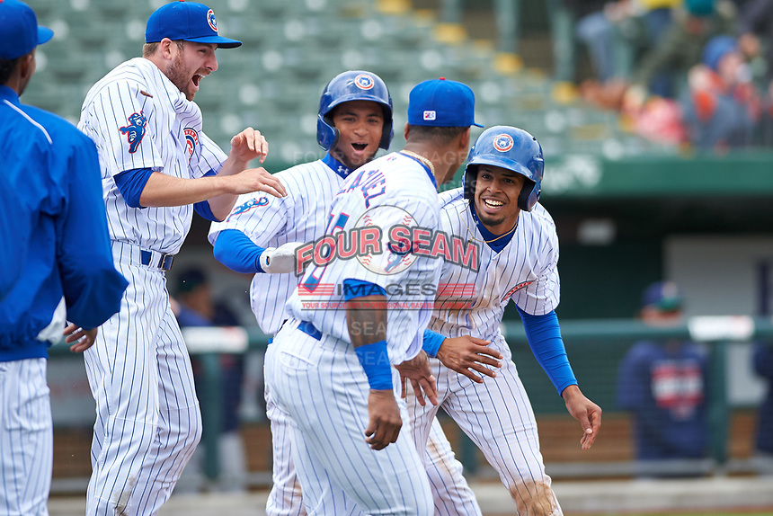 South Bend Cubs Ryan Lawlor (21), D.J. Artis (11), Nelson Velazquez (13), and Christopher Morel (29) celebrate a walk-off victory after a Midwest League game against the Cedar Rapids Kernels at Four Winds Field on May 8, 2019 in South Bend, Indiana. South Bend defeated Cedar Rapids 2-1. (Zachary Lucy/Four Seam Images)