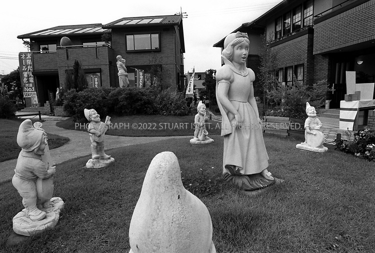 July, 2002--Kyoto, Japan..Snow White and the Seven dwarfs in the gardens of model , prefabricated homes for sale...All photographs ©2003 Stuart Isett.All rights reserved.This image may not be reproduced without expressed written permission from Stuart Isett.