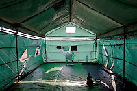 A Rohingya Muslim baby sits inside a tent at the camp for people displaced by violence near Sittwe April 27, 2013. Picture taken April 27, 2013.   REUTERS/Damir Sagolj (MYANMAR)