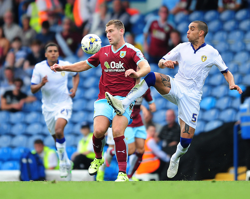 Burnley's Sam Vokes vies for possession with Leeds United's Giuseppe Bellusci<br /> <br /> Photographer Chris Vaughan/CameraSport<br /> <br /> Football - The Football League Sky Bet Championship - Leeds United  v Burnley - Saturday 8th August 2015 - Elland Road - Beeston - Leeds<br /> <br /> &copy; CameraSport - 43 Linden Ave. Countesthorpe. Leicester. England. LE8 5PG - Tel: +44 (0) 116 277 4147 - admin@camerasport.com - www.camerasport.com