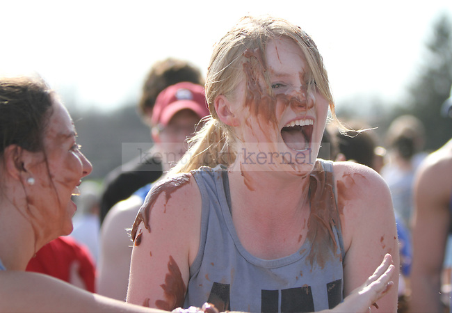 Melissa Homann laughs after a teammate poured pudding on her head during the pudding pass event at the Pi-Athlon, a charity event hosted by Alpha Omicron Pi, Iota Phi Theta and Iota Phi Theta to benefit the local Arthritis Foundation, the IOTA Youth Alliance and the Leukemia and Lymphoma Society. The event took place on the E. S. Good Barn field on the University of Kentucky campus in Lexington, Ky., on Wednesday, April 10, 2013. Photo by Becca Clemons | STAFF