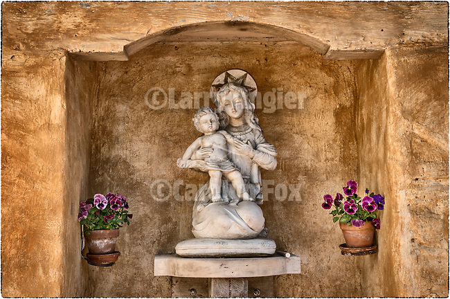 Madonna and child statue in a niche at Carmel Basilica and Mission, Carmel, Calif.
