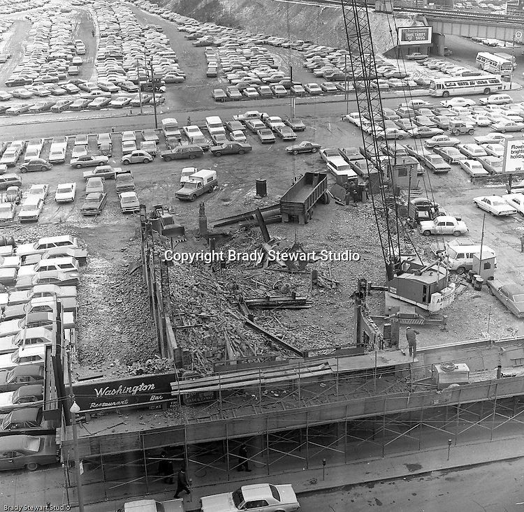 Pittsburgh PA:  The ongoing demolition of distressed buildings on upper Liberty and Penn Avenues to create revenue generating parking lots and areas for future development.<br />