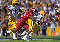 NWA Democrat-Gazette/BEN GOFF @NWABENGOFF<br /> Dre Greenlaw (left) and De'Jon Harris, Arkansas linebacker, tackle Derrius Guice, LSU running back, in the first quarter Saturday, Nov. 11, 2017 at Tiger Stadium in Baton Rouge, La.