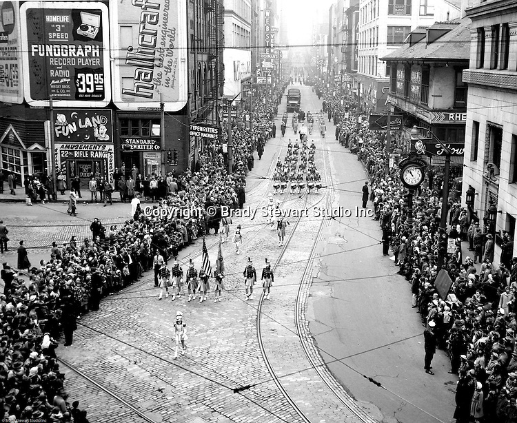 Pittsburgh PA:  View of the Annual Veteran's Day Parade in Pittsburgh - 1957. View of the parade coming down Fifth Avenue to Liberty Avenue; photo taken from the 3rd floor of an office in the Jenkin's Arcade.  Pittsburgher's have always enjoyed a good parade down Fifth Avenue to Liberty Avenue and finish at Water Street.