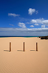 Three wooden posts on the beach, Morro Jable, Fuerteventura, Canary Islands, Spain. May 2007.
