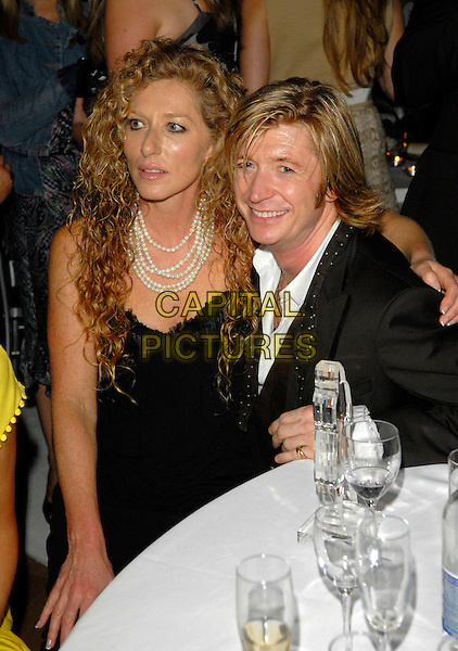 KELLY HOPPEN & NICKY CLARKE.The Grazia O2 Awards, Sunbeam Studio, London, .England, July 19th 2007. .half length black strapless dress sitting on lap couple table.CAP/FIN.©Steve Finn/Capital Pictures.