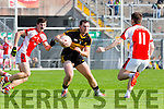 Cathal Murphy Rathmoreand Daithi Casey Dr Crokes challenge for the loose ball during their County Championship Q/F in Fitzgerald Stadium on Sunday