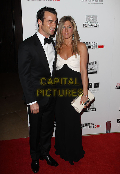 Justin Theroux, Jennifer Aniston.American Cinematheque 26th Annual Award Presentation To Ben Stiller 2012 Held At The Beverly Hilton Hotel, Beverly Hills, California, USA, .15th November 2012.full length black tuxedo tux bow tie suit couple fiance fiancee engaged strapless white bow dress long maxi clutch bag .CAP/ADM/KB.©Kevan Brooks/AdMedia/Capital Pictures.