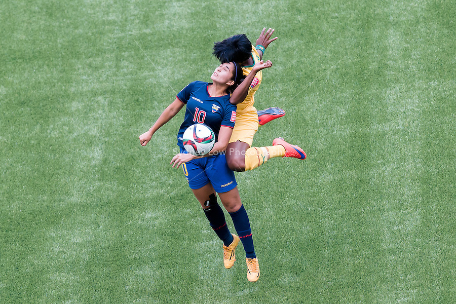 June 8, 2015:  Ambar TORRES of Ecuador and Raissa FEUDJIO of Cameroon competes for the ball during a Group C match at the FIFA Women's World Cup Canada 2015 between Cameroon and Ecuador at BC Place Stadium on 8 June 2015 in Vancouver, Canada. Sydney Low/AsteriskImages