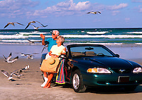 Retired couple relaxing on the beach