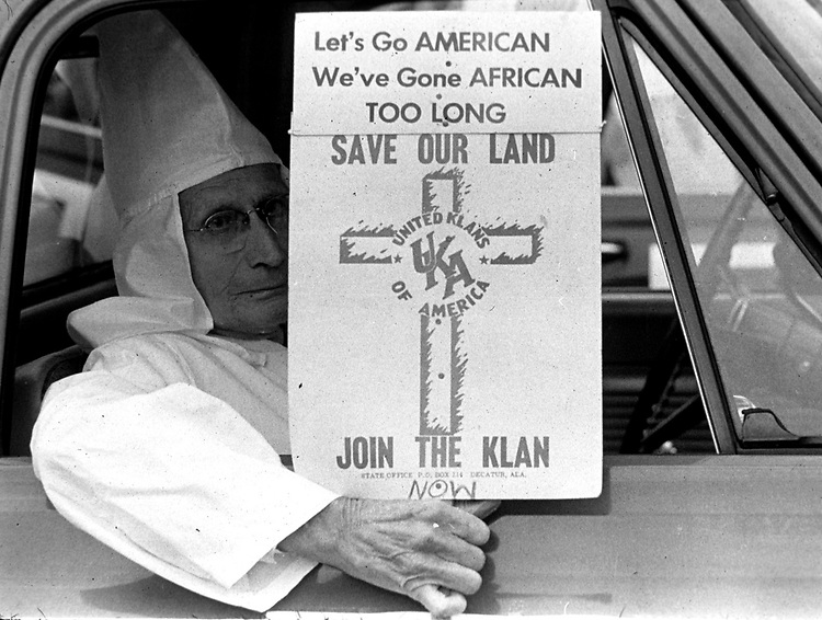 Old man shows sign during Ku Klux Klan parade along Dexter Ave. in Montgomery, Ala in December, 1967 to protest Dr. Martin Luther King Jr speaking at Dexter Ave. Baptist Church on Anniversary of Montgomery Bus Boycott. (Photo by Jim Peppler published in The Southern Courier Dec. 16, 1967). Copyright Jim Peppler/1967. This and over 10,000 other images are part of the Jim Peppler Collection at The Alabama Department of Archives and History:  http://digital.archives.alabama.gov/cdm4/peppler.php
