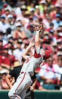 NWA Democrat-Gazette/CHARLIE KAIJO Arkansas infielder Jax Biggers (9) reaches for a ball during the second game of the NCAA super regional baseball, Sunday, June 10, 2018 at Baum Stadium in Fayetteville. Arkansas fell to South Carolina 5-8.