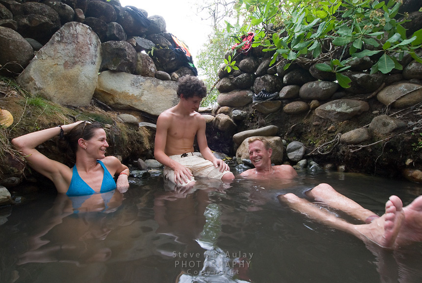Young friends enjoying the natural hotsprings near Boquete, Panama, Chiriqui Province