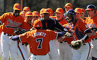 Clemson head coach Jack Leggett jumps into the arms of his team just prior to the opening game of the 2008 season between the Mercer Bears and Clemson Tigers at Doug Kingsmore Stadium, in Clemson. Clemson beat Mercer 12-5. Photo by:  Tom Priddy/Four Seam Images