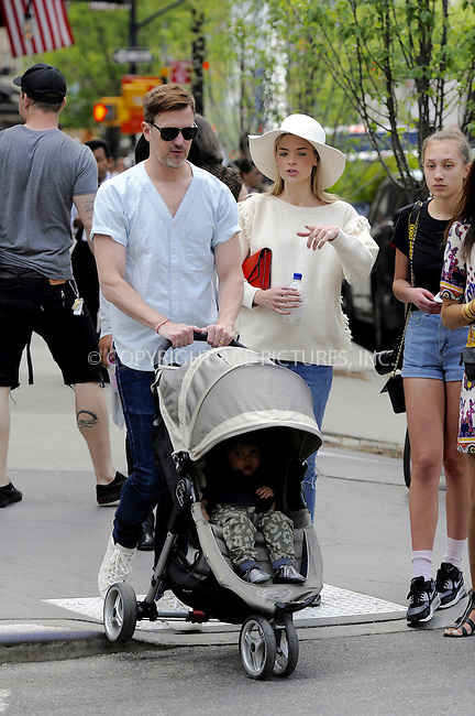 WWW.ACEPIXS.COM<br /> <br /> May 5 2015, New york City<br /> <br /> Actress Jaime King walks in Tribeca with her hsuband Kyle Newman and her son James on May 5 2015 in New York City<br /> <br /> By Line: Curtis Means/ACE Pictures<br /> <br /> <br /> ACE Pictures, Inc.<br /> tel: 646 769 0430<br /> Email: info@acepixs.com<br /> www.acepixs.com