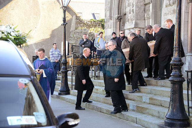 12/11/2013 - Paddy Cluskey's coffin is carried out of St. Mary's Church.
