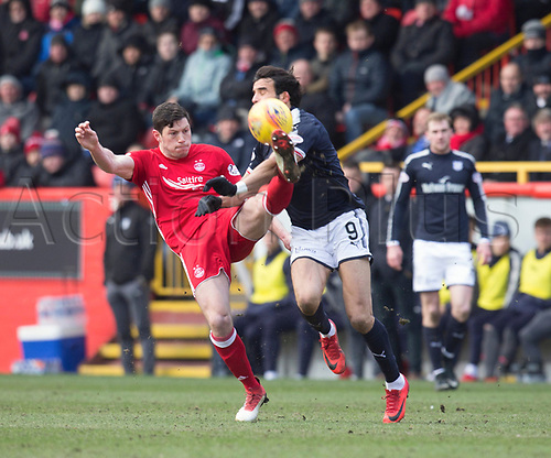 17th March 2018, Pittodrie Stadium, Aberdeen, Scotland; Scottish Premier League football, Aberdeen versus Dundee; Scott McKenna of Aberdeen clears from Sofien Moussa of Dundee