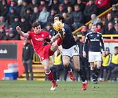 17th March 2018, Pittodrie Stadium, Aberdeen, Scotland; Scottish Premier League football, Aberdeen versus Dundee; Scott McKenna of Aberdeen clears from Sofien Moussa of Dundee