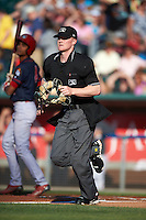 Umpire Thomas Roche gets in position during a game between the Peoria Chiefs and Lansing Lugnuts on June 6, 2015 at Cooley Law School Stadium in Lansing, Michigan.  Lansing defeated Peoria 6-2.  (Mike Janes/Four Seam Images)