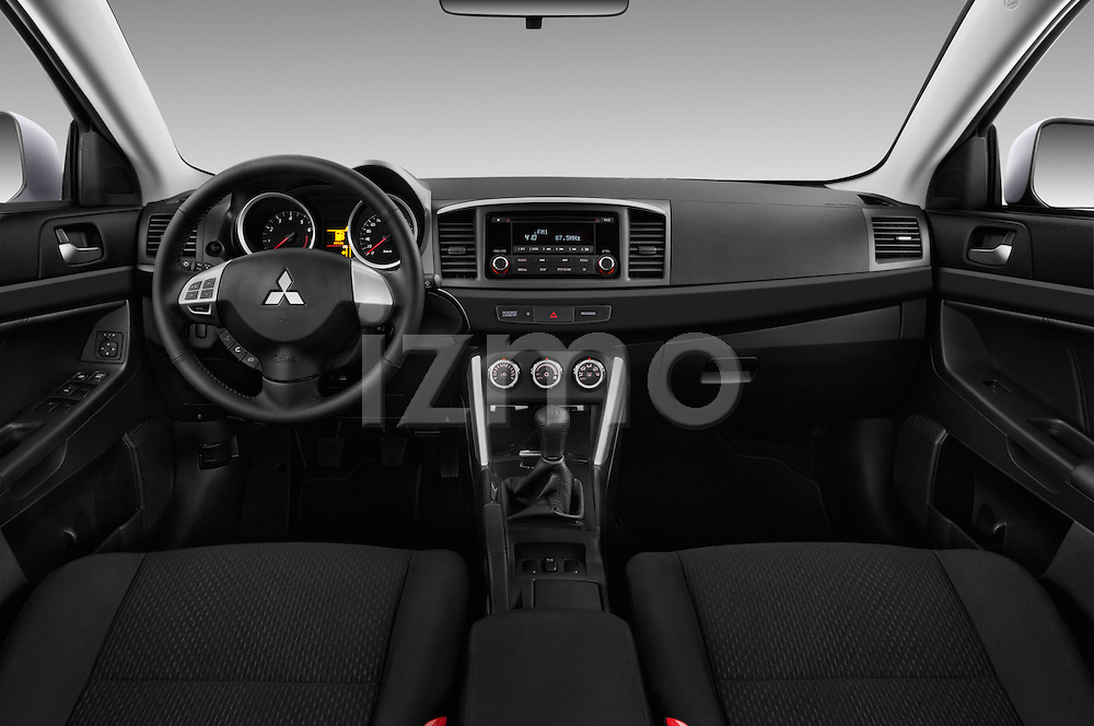 Stock photo of straight dashboard view of 2016 Mitsubishi Lancer Intense 4 Door Sedan Dashboard