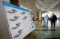 NWA Democrat-Gazette/DAVID GOTTSCHALK Renderings are displayed Monday, March 5, 2018, inside the lobby of the Fayetteville Public Library. The Library Board is in the design stages of expansion on properties that includes the Old City Hospital.