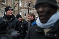 Demonstration in Dessau anlaesslich des 12. Todestages des Fluechtling Oury Jalloh, der am 7. Januar 2005 unter bislang nicht geklaerten Umstaenden in Polizeihaft, in der Zelle gefesselt, bei lebendigem Leib verbrannte.<br /> An der Demonstration beteiligten sich ca. 1.500 Menschen.<br /> Im Bild: Andre Poggenburg, AfD-Fraktionsvorsitzender im Landtag von Sachsen-Anhalt, betrachtete die Demonstration unter Polizeischutz.<br /> Links von Poggenburg: Mario Lehmann, AfD-MdL.<br /> 7.1.2017, Dessau<br /> Copyright: Christian-Ditsch.de<br /> [Inhaltsveraendernde Manipulation des Fotos nur nach ausdruecklicher Genehmigung des Fotografen. Vereinbarungen ueber Abtretung von Persoenlichkeitsrechten/Model Release der abgebildeten Person/Personen liegen nicht vor. NO MODEL RELEASE! Nur fuer Redaktionelle Zwecke. Don't publish without copyright Christian-Ditsch.de, Veroeffentlichung nur mit Fotografennennung, sowie gegen Honorar, MwSt. und Beleg. Konto: I N G - D i B a, IBAN DE58500105175400192269, BIC INGDDEFFXXX, Kontakt: post@christian-ditsch.de<br /> Bei der Bearbeitung der Dateiinformationen darf die Urheberkennzeichnung in den EXIF- und  IPTC-Daten nicht entfernt werden, diese sind in digitalen Medien nach §95c UrhG rechtlich geschuetzt. Der Urhebervermerk wird gemaess §13 UrhG verlangt.]