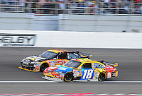 Mar. 1, 2009; Las Vegas, NV, USA; NASCAR Sprint Cup Series driver Kyle Busch (18) races alongside Jeff Burton for the lead during the Shelby 427 at Las Vegas Motor Speedway. Mandatory Credit: Mark J. Rebilas-