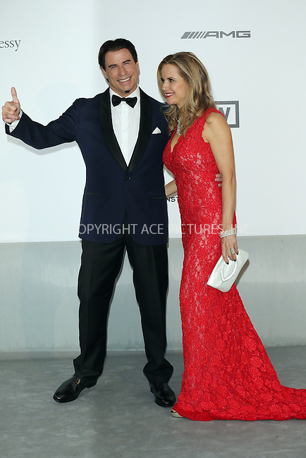ACEPIXS.COM<br /> <br /> May 21 2014, Cannes<br /> <br /> John Travolta and wife Kelly Preston arriving at amfAR's 21st Cinema Against AIDS Gala during the 67th Cannes International Film Festival at Hotel du Cap-Eden-Roc on May 21 2014 in Cap d'Antibes, France<br /> <br /> By Line: Famous/ACE Pictures<br /> <br /> ACE Pictures, Inc.<br /> www.acepixs.com<br /> Email: info@acepixs.com<br /> Tel: 646 769 0430