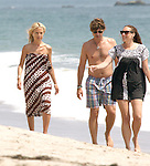 8-16-09.Exclusive...Rachel Zoe walking on the beach in Malibu California with her husband Rodger Berman. Rachel's shoulders looked super skinny wearing a low cut brown & white retro 70's dress...AbilityFilms@yahoo.com.805-427-3519.www.AbilityFilms.com