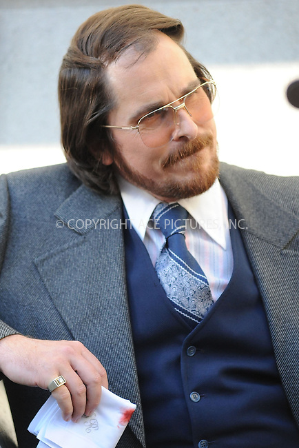 WWW.ACEPIXS.COM . . . . . .May 17, 2013...New York City...Christian Bale on the film set of 'American Hustle' in Lower Manhattan on May 17, 2013 in New York City. ....Please byline: KRISTIN CALLAHAN - WWW.ACEPIXS.COM.. . . . . . ..Ace Pictures, Inc: ..tel: (212) 243 8787 or (646) 769 0430..e-mail: info@acepixs.com..web: http://www.acepixs.com .