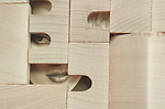 A hidden womans face behind wooden blocks
