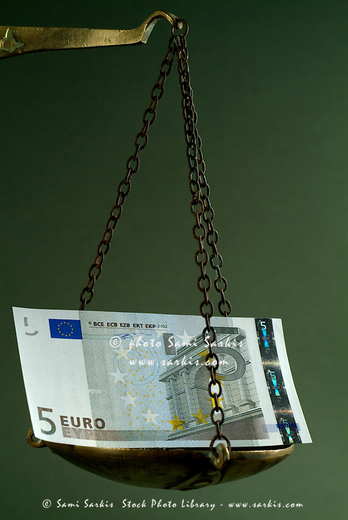 Scale weighing a five Euro banknote.