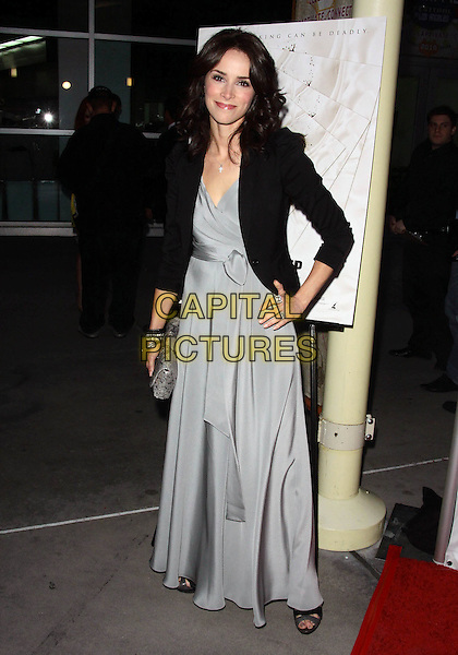 """ABIGAIL SPENCER .""""In My Sleep"""" - Los Angeles Premiere -Arrivals held at The ArcLight Cinemas, Hollywood, California, USA, .15th April 2010..full length grey gray silver long maxi dress black jacket clutch bag hand on hip .CAP/ADM/TC.©T. Conrad/AdMedia/Capital Pictures."""