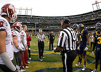 Washington State and California captains watch referee Jay Stricherz tosses a coin before the game at AT&T Park in San Francisco, California on November 5th, 2011.  California defeated Washington State, 30-7.