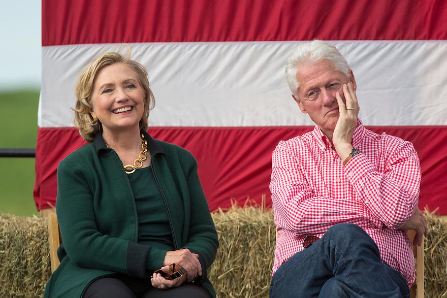 Hillary and Bill Clinton cook steaks with Iowa Senator Tom Harken at his annual Steak Fry in Indianola,  Iowa
